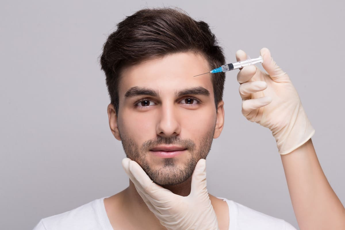 Filler forehead injection for male face in beauty clinic